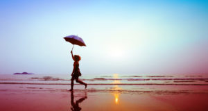 silhouette of happy running woman with umbrella