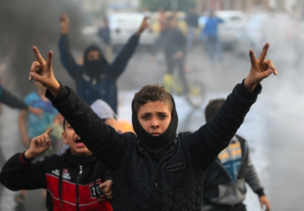 Palestinian youths take part in a protest in Gaza